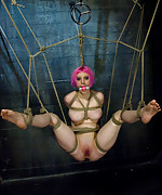 Latex beauty in intense bondage play