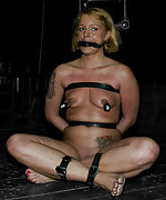 Two slaves bound in metal and devices tortured