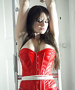 Sexy dressed woman roped to the ladder