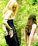 Cuffed blonde escorted in the forest