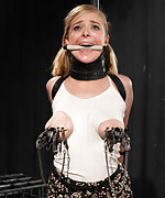 Blondie subjected to brutal bondage with her tits tied tight