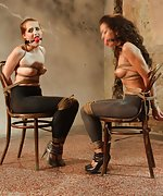 Two girls chair-tied, ball-gagged, struggling, moaning, whining