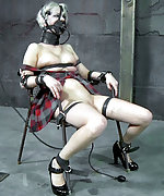 Fixed with leather straps, tightly gagged, dildoed