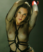 Hot brunette with rope around her body