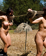 Two slave girls tied and trained to fuck at the ranch