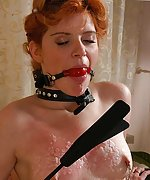 Redhead cuffed, ball-gagged and trained