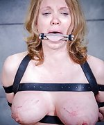 Two girls tied with leather belts and machine-fucked