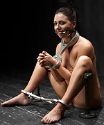 Hot brunette gets shackled, chained, double penetrated