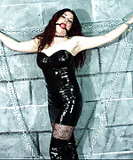 Black latex dress, high boots and chains