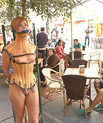 Sexy model is bound and led through the streets