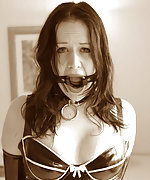 Kinky milf is bound in a range of bondage gear and latex