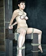 Tied up in a seat, tit clamped, caned and teased