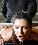 Brunette roped to the bed and fucked by two men