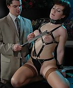 Brunette tied, clamped and waxed