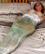 Kerri gets mummified on the bed