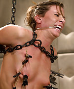 Cuffed, chained, zipped, plugged, dildoed