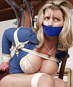 Busty milf gets roped and tape-gagged