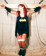 Superheroine is crucified and cleave-gagged
