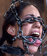 Sexy slut is immobilized by hard steel and leather