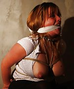 Lola is helplessly roped and cleave-gagged