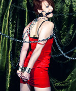 Redhead cuffed, chained and bit-gagged