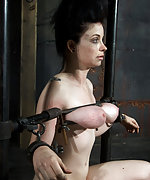 Cuffed, fixed with metal device and punished