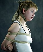 Roped in predicament bondage, stripped and trained