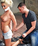 Karol gets hogtied, mouth-stuffed, tape-gagged