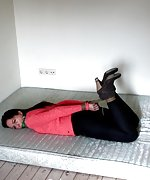 Lena struggling on a matras - hogtied and ball-gagged