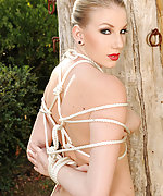 Sexy blonde gets stripped and roped to the tree