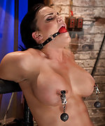 Busty brunette roped, gagged, tits clamped, pegged & vibed