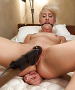Rich blond captured and bound with tape