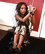 Ebony beauty cuffed and chained