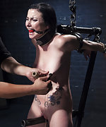 Fixed in metal bondage, whipped, clamped, forced to cum
