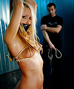 Nicole is tied up, tape-gagged, whipped