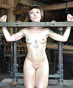 Locked into the stocks, chained and suspended