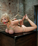 Busty blonde in tight inescapable bondage