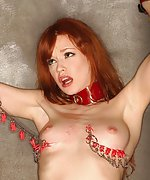 Redhead clamped, cuffed and dildoed