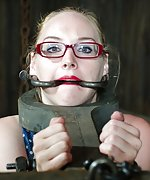 Locked in stocks, cuffed, tits clasped, tightly gagged