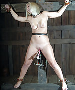 Cuffed to the cross, locked, whipped and vibed