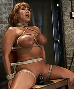 Big titted MILF is bound brutally to a chair and vired to cum